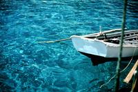 Turquoise Turkey boat resting in Aegean Sea Turkey