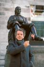 Spaulding Gray in front of John Harvard Cambridge MA